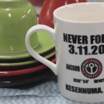 """Memorial Coffee Mug"", Kesennuma, Miyagi, August 9, 2014: A memorial mug serves as a reminder to ""Never Forget."" Mr. Onodera and his business hope the disaster will be remembered to honor those lost and stay connected to 3.11."