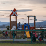 """Oshima"", Kesennuma, Miyagi, November 8, 2014: Children resume playing on newly installed playground equipment as a disaster drill hosted by the Ground Self-Defense Force (not photographed) finishes. The school ground next to the playground has become a helicopter station for the drill."