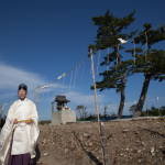 """Shinto Priestess"", Yamamoto, Miyagi, October 24, 2014: Shoko Fujinami (59) is the Chief Priestess of Yaegaki Jjina, which was founded in AD 807.  Although the shrine was washed away, many temporary housing residents still visit here – some come to cry, some to pray. With help from the Nippon Foundation, plans are underway to rebuild the shrine in 2016."