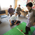 """Temporary Housing Community"", Yamamoto, Miyagi, October 24, 2014: Senior citizens, mostly women, gather in temporary housing to play ""scat ball"" or sing karaoke. They support each other by sharing laughter, food and stories. This temporary housing is slated to close in the next couple years."