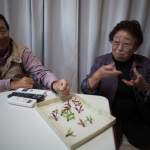 """Temporary Housing Residents"", Yamamoto, Miyagi, October 24, 2014: Ikuko (80) and Umeo (78) Chihiro are moving to newly built public housing this spring. Ikuko, a former kimono maker, has been unable able to work due to lack of space. Umeo says, ""we try to live with a forward looking attitude."""