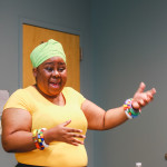 Vuyiswa Tulelo, Consul General of South Africa in Chicago, speaks to the girls.