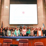 Participants with Chicago Deputy Mayor Andrea Zopp at Chicago City Council Chambers.