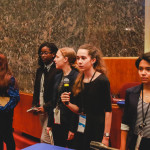 Celestine Gamet of Paris presents with her group at Chicago City Council Chambers.